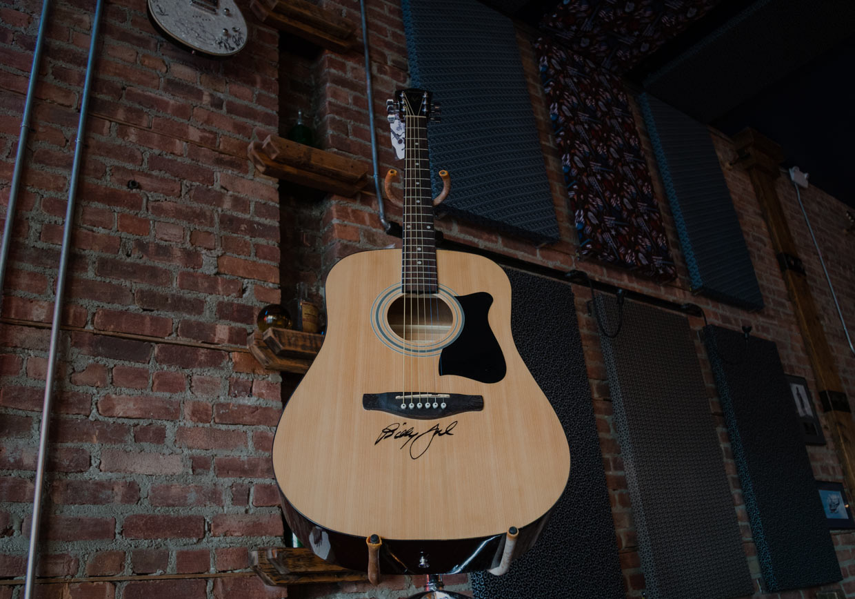 benefit friends and fallen heroes. enter to win an acoustic guitar signed by Billy Joel