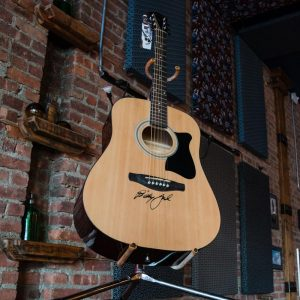 win an acoustic guitar signed by Billy Joel